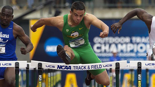 UO athlete jumping hurdles