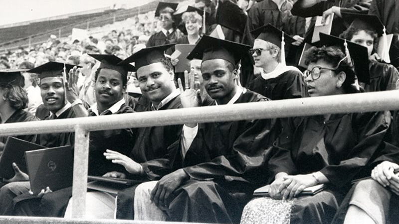 Historic photo of Black UO students in graduation caps and gowns