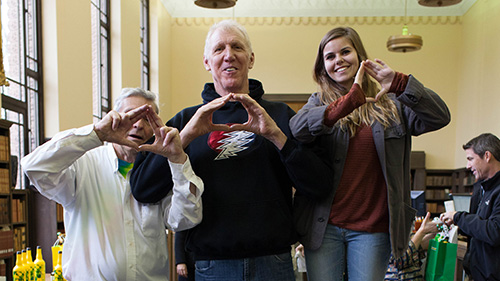 "Ken Babbs, Bill Walton, and Leah Braunstein throwing the ""O"" in Special Collections and University Archives"