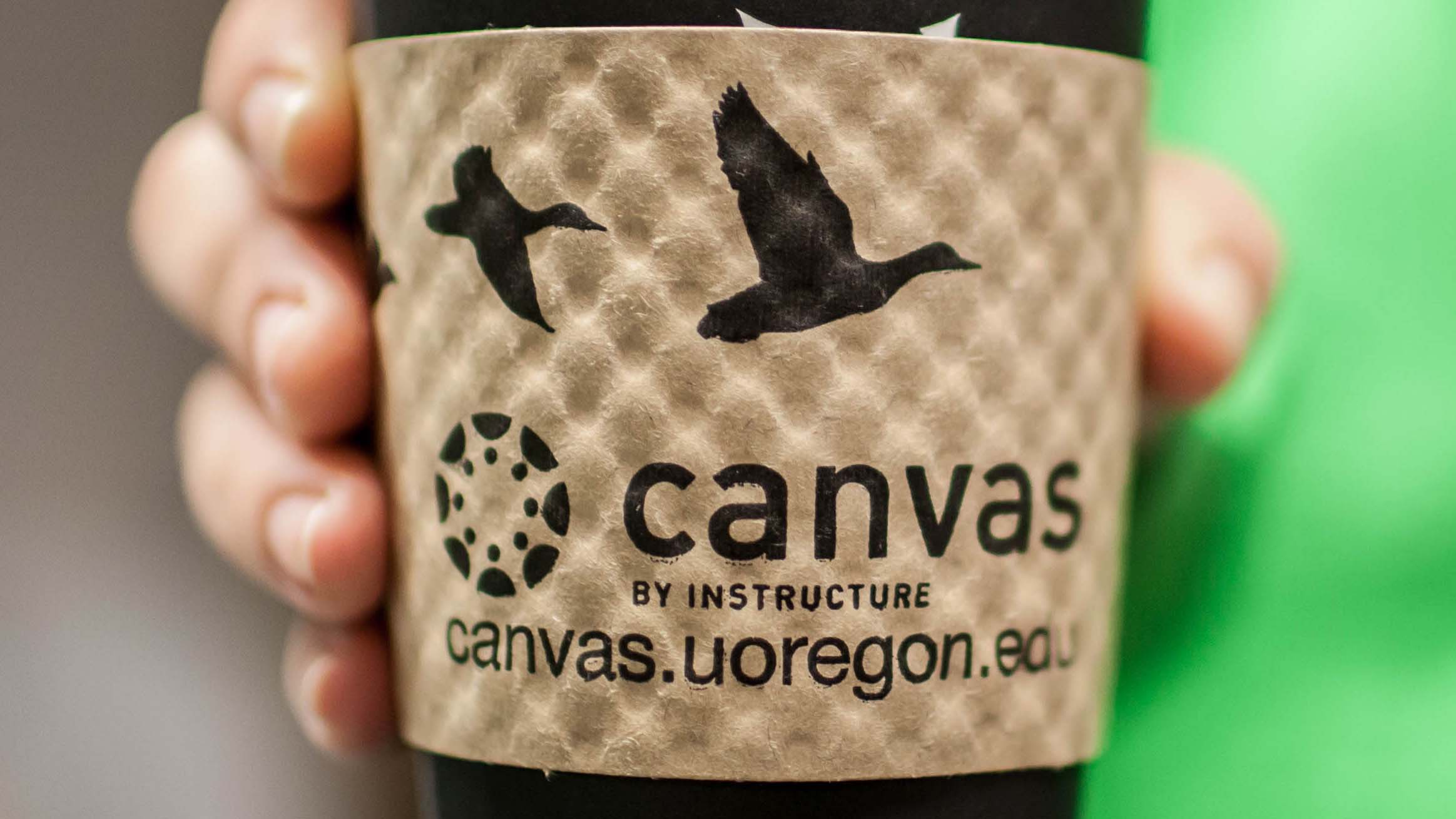 takeout coffee cup with Canvas promotional sleeve