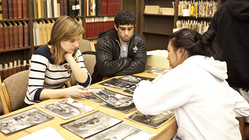 students looking at photos in special collections