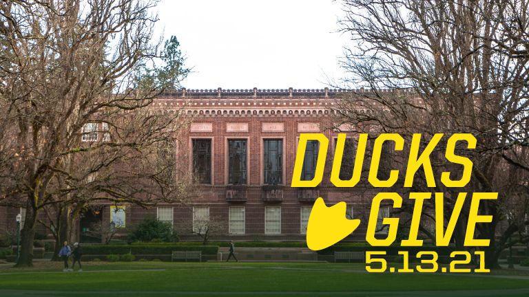 Ducks Give logo with a photo of Knight Library in the background