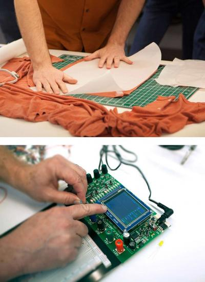 Hands laying out embrodery and another pair of hands working on electronics