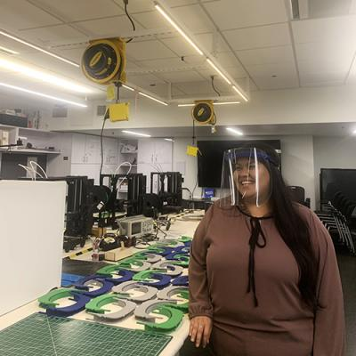 Melissa Galvan wears a face shield in the Makerspace