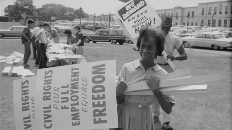 woman holding signs