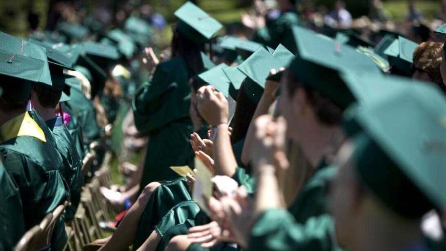 Photo of graduates in caps and gowns at UO Commencement