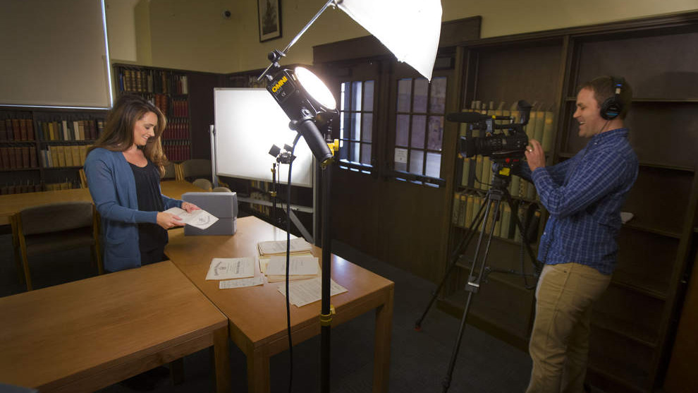 University Archivist Jennifer O'Neal on camera in Special Collections and University Archives at Knight Library