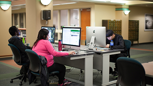 Students at computers in open room