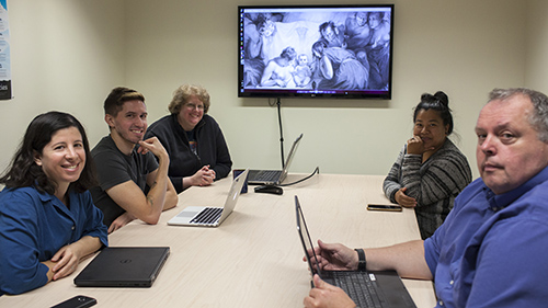 Professor Lara Bovilsky collaborating with staff of the UO Libraries' Digital Scholarship Center