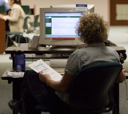 image: student using library computer
