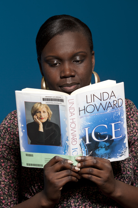 Student reading book called Ice by Linda Howard