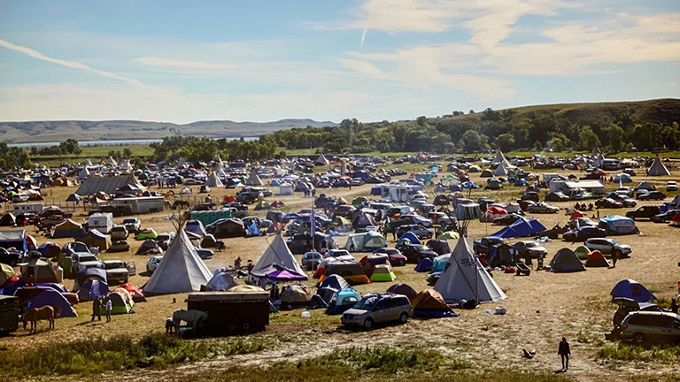 landscape photo of people camped at Standing Rock