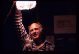 kesey holding a light