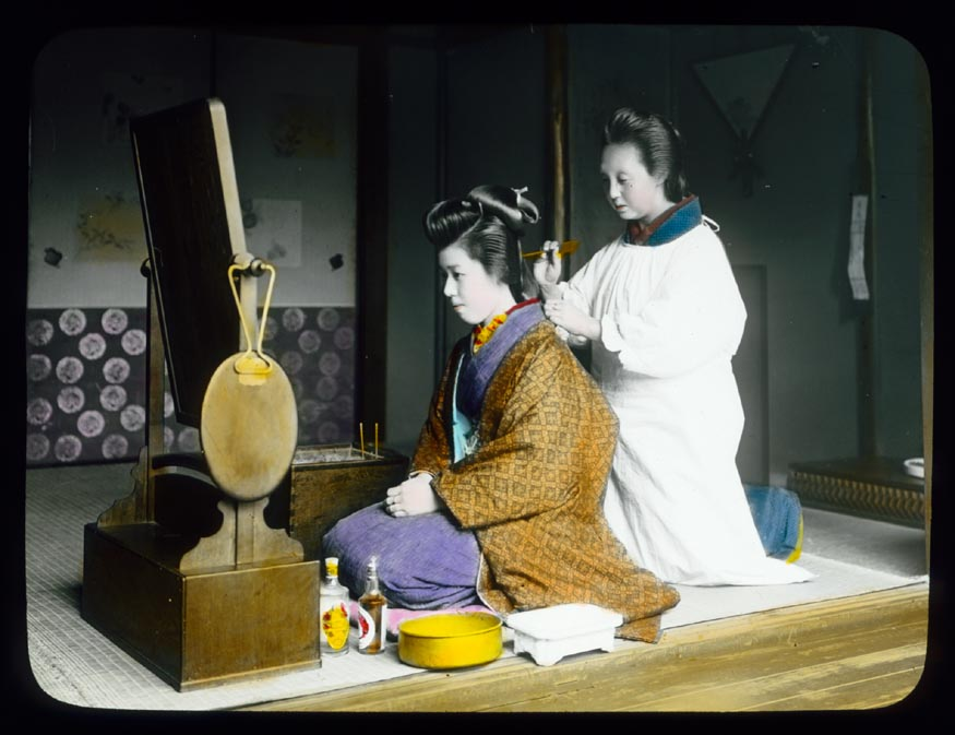 Warner image of Japanese woman at toilette