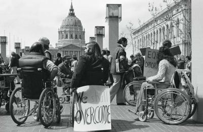 Section 504 protesters demonstrate with signs and placards outside San Francisco's City Hall, April 5, 1977. Photograph by Anthony Tusler
