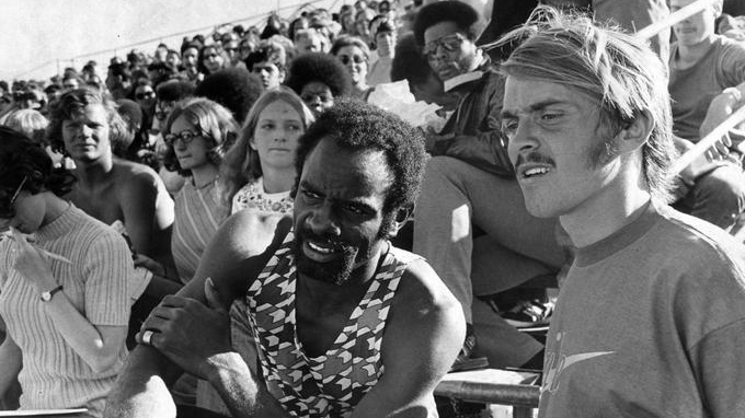 University of Oregon distance runner Steve Prefontaine (right) with Texas Southern sprinter Robert Taylor, watching action on the track at the 1972 Olympic Trials.