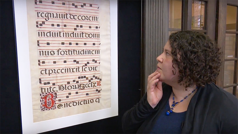 Curator Dr. Vera Keller discussing medieval music and manuscripts.