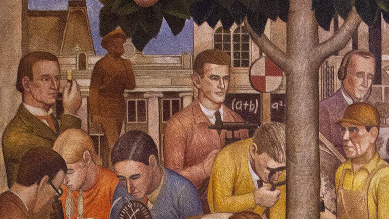"Detail of the ""Development of Science"" mural with Pioneer Father statue in background"