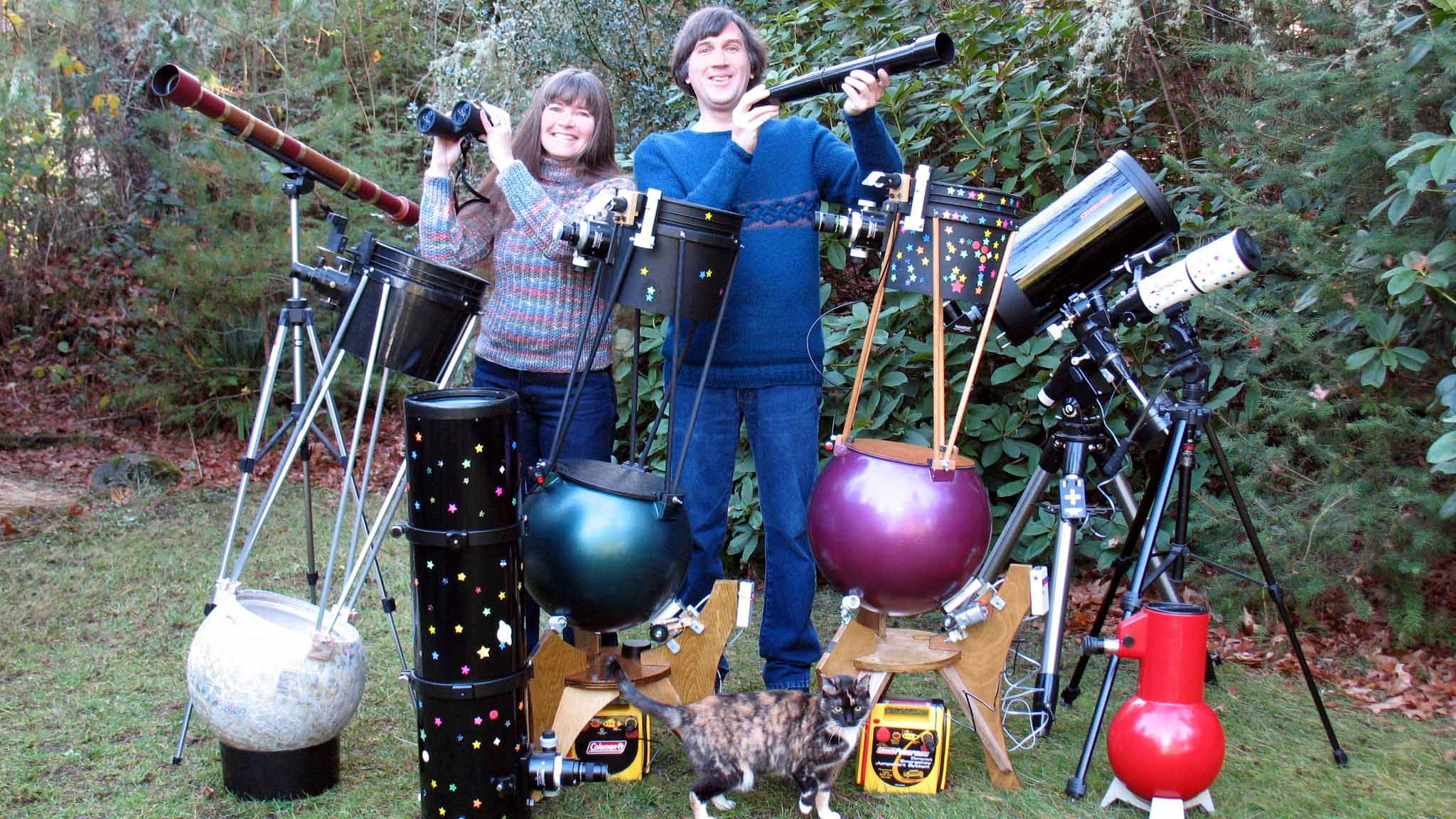 "Jerry Oltion,""Sky and Telescope"" columnist and science fiction author, poses with several of his homemade telescopes."