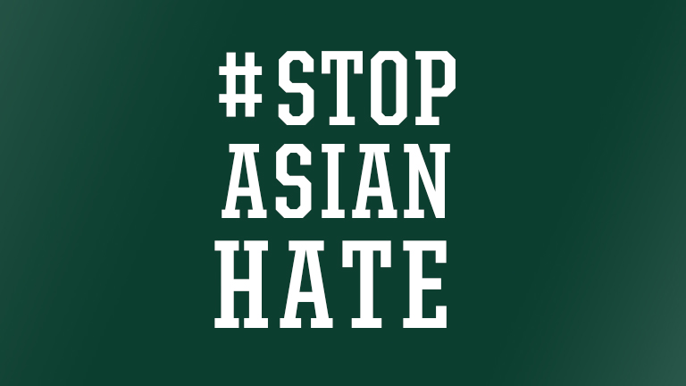 The words, # Stop Asian Hate, on a green background
