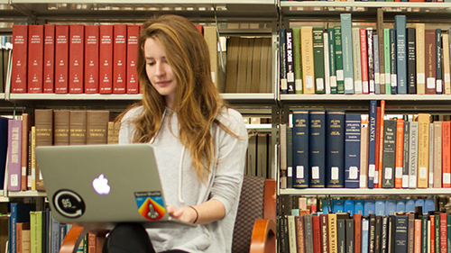 girl with laptop in library