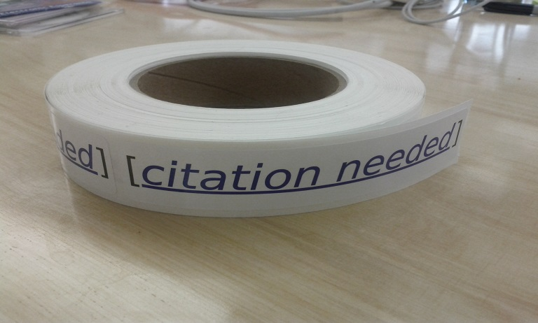 "Roll of ""citation needed"" stickers."