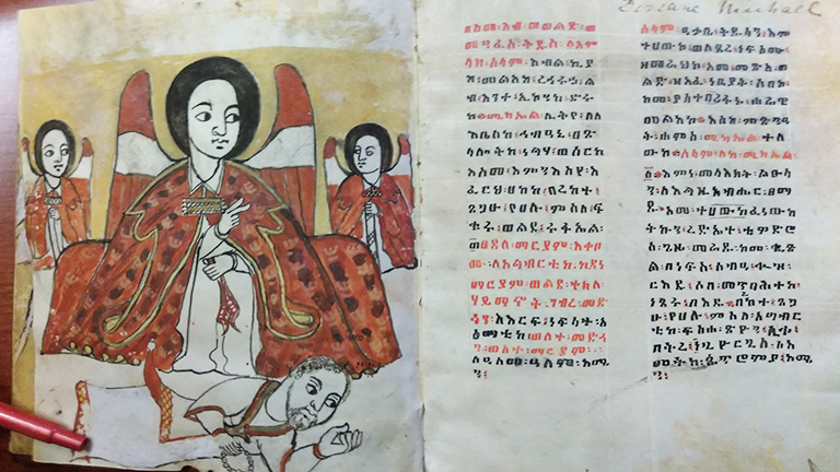 Open spread of an Ethiopian manuscript with an illustration on the verso and text on the recto.