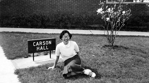 Student Yoko McClain sits outside Carson Hall at the University of Oregon, 1952.